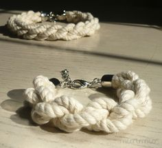 Eco-friendly nautical fashion urban cuff bracelet.Natural twisted cotton ropes, silver colored end caps.Ready to ship