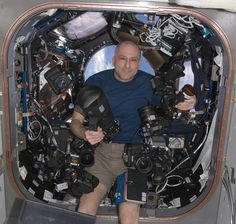 Camera porn: NASA astronaut Don Pettit on board the ISS with a bunch of Nikon cameras and lenses. OH MY!!!