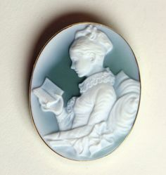 """Young Girl Reading"" Cameo (The cherished French painting rendered by the French artist, Fragonard, has been interpreted in a blue-green agate. Hand-carved.)"