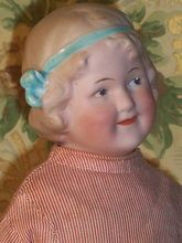 Coquette bisque head doll....  Gebruder Heubach  early 1900's.
