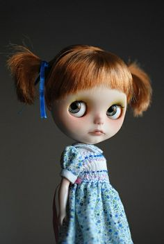 She looks like she just got in trouble. I love the Blythe dolls !!!