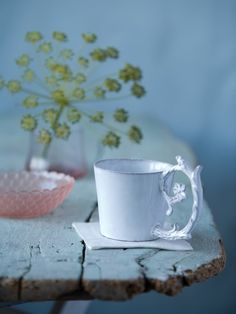 ... that astier de villatte cup! ... the simple flare of the cup and the calligraphy flourish handle - exquisite.