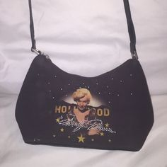 Vintage Marilyn Monroe handbag This is a vintage, leather, Marilyn Monroe bag that is a black color with a beautiful photo of Marilyn. The handbag is bedazzled with gems around classic photo of Marilyn. I collected these hand bags so it literally hung in a glass cabinet. perfect for any Marilyn Monroe enthusiast!!! This handbag is small borderline quick size but has a strap that can hold the bag from your shoulder. It's size has plenty of room for your wallet make up day planner and iPhone…