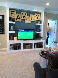 Love the scrabble letters...kids room... family room last name...oh the possibilities