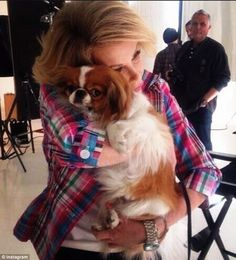 Puppy love: Joan Rivers with Teegan earlier this year, she has left a chunk of her estimated $150 million fortune to her four rescue pups. Joan just loved animals, her dogs were like additional children. Bless her and them, xxx