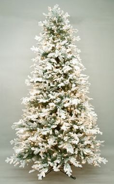 A flocked Christmas tree makes a gorgeous statement. Decorate with white, silver, glass sparkly ornaments and wrap some crushed white soft velvet material around the bottom and you will have a stunner!
