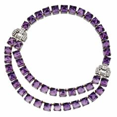 Amethyst and Diamond Necklace composed of sugarloaf cabochon amethysts decorated at the sides with a pair of buckle motifs set with round and baguette diamonds weighing approximately 5.00 carats, mounted in silver.