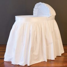 Bratt Decor's stunning  bebe pique bassinet - white.  Shop www.brattdecor.com for luxury baby furniture in a wide variety of styles and price points.