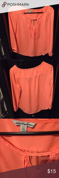 Coral blouse Very cute, quarter sleeve, flowy coral top. The front has fringe that hangs. Will accept offers! American Eagle Outfitters Tops Blouses