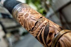 Hand tooled leather bow handle, by Fischer Workshops fischerworkshops.com