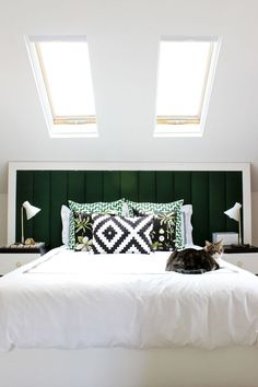 Custom headboard in a cozy modern style and great palette of emerald/forest green, black, and white. | Mandy Pellegrin's home featured in A Beautiful Mess