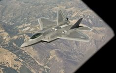 10/24/2013 - An F-22 Raptor assigned to the 49th Fighter Wing, at Holloman Air Force Base, N.M., flies next to a KC-135 Stratotanker from McConnell Air Force Base, Kan., Oct. 23, 2013, during a refueling mission. McConnell's refueling capability drastically increases the effectiveness and reach of the F-22. (U.S. Air Force photo/Airman 1st Class John Linzmeier)