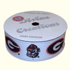 University of Georgia white hair ribbon with repeating Bulldog Head and Georgia G logos. 7/8 thick, 3 yards.
