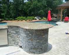 Kitchen Sleek Modular Granite Countertops Design Traditional Patio Design With Swimming Pool Surrounded By Lush Vegetations Santa Cecilia Showing Outdoor Kitchen Outside Kitchen Design With Stonework And Granite Counter Tops