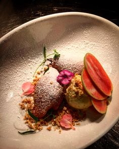 Squash blossom stuffed with ricotta and sweetened with brown sugar. Plated with candied almonds, mountain rose apples, deep-fried funnel cake, brown butter ice cream.