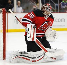 New Jersey Devils goalie Cory Schneider makes a save against the Toronto Maple Leafs during the first period of an NHL hockey game, Friday, Feb. 6, 2015, in Newark, N.J. (AP Photo/Julio Cortez)