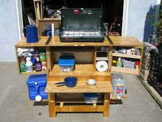 Chuck box camp kitchen!  It's the ultimate neat and tidy kitchen that unfolds and becomes the hit of the camp out!  DIY - not sure I can do this but it's cool!
