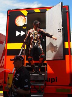 Colin Edwards MotoGP thinking he's David Hasselhoff coming out of his vehicle trailer.  'cept CEII is more virile.