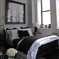 Dark, masculine bedroom decor. Neutral bedding.