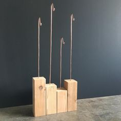 Copper wire and wood necklace displays. Kelly Conner