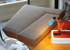 This is an excellent post about making new cushions for your boat's settee and v-berth from cutting foam, fabric selection, measuring, corners and buttons. #diy #boatcushions