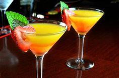 Applebee's Mango Martini recipe; 1 oz Captain Morgan® Parrot Bay mango rum 1/2 oz peach schnapps 1/2 oz Cointreau® orange liqueur 1 oz cranberry juice 1 oz pineapple juice