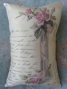 Romance is in the air with this romantic pillow that has an actual French letter on it and a gorgeous vase of pink roses...this one is beautiful ...every woman would love to receive it only $12