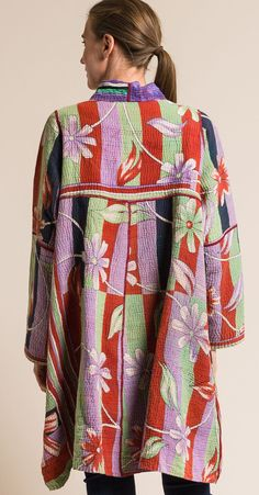 $810.00 | Mieko Mintz 4-Layer Vintage Cotton A-Line Duster Jacket in Lime/Lavender | Mieko Mintz creates clothing from vintage saris, which are upcycled into new fashion. The reversible clothing is an artful multi-pattern combination of by Mieko that is then made into kantha fabric. Sold online and in-store at Santa Fe Dry Goods in Santa Fe, New Mexico. Quilted Clothes, Duster Jacket, Kimono Fabric, Dry Goods, Coat Patterns, Caftans, Kantha Quilt, Vintage Cotton, Santa Fe