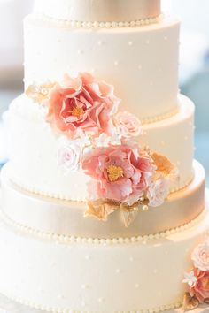 Modern wedding cake with iced swiss dots, gold accents, and pink flower decor {Keepsake Memories Photography}
