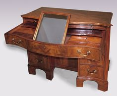 A fine 18th Century mahogany kneehole Dressing Chest having moulded edge top above brushing slide, fitted top drawer,six short graduated cockbeaded drawers and cupboard in central recess,supported on bracket feet. Circa: 1790