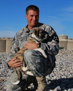 A soldier in Afghanistan saves a 4 week old pup from a trash burn pit.