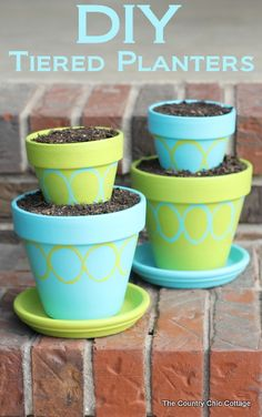 DIY Tiered Planter Pots for your garden -- made from terra cotta pots and painted with toilet paper rolls!