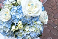 Blue hydrangea, white rose, and blue gem wedding bouquet by Reynolds Treasures, Charleston, SC
