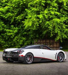 Pagani Huayra painted in White w/ exposed Carbon Fiber and red accents Photo taken by: @drivingforceclub on Instagram