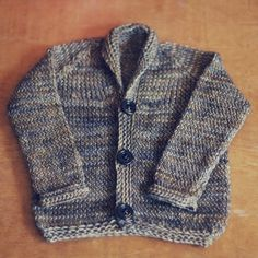 New free knitting pattern! Twisted Stockinette Baby Cardigan by The Black Squirrel Blog. Too cute!