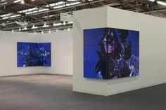 """Video installation artist Diana Thater uses Planar's Clarity Matrix as her digital canvas at the Armory Show 2013 in New York. """"Video walls wrap around the corners of the booths in lush, flickering bouquets of purple clematis."""""""