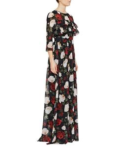 Winter Roses –Blugirl Fall Winter 2016/2017 • Long Chiffon Dress With Roses Print • The round neck chiffon cocktail dress with bicolor pictorial roses print has three-quarter sleeves, flounces on the top and a pleated motif on the skirt. The ethereal silhouette elegantly emphasizes the waist. The slip with shoulder straps matches.