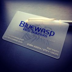 A frosted translucent plastic business card printed with 3 ink colours (dark blue, metallic silver and clear ink on the back to create a watermark effect)