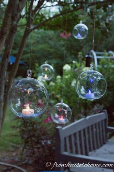 Red, white and blue flameless tealights hanging from tree | Easy Fourth Of July Ourdoor Decor Ideas