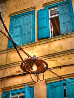 A lamp suspended above an alleyway in the Greek town of Chania, Crete.