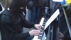 Just a Ukrainian soldier playing the piano