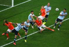 Players vie for control of the ball during the semifinal soccer match between Netherlands and Argentina. (Julian Finney/Getty Images)