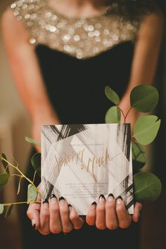 love the gold and black of the whole wedding shoot, very modern- and check out those nails! Photo viaJenavieve Belair