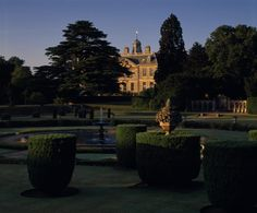 Belton house, with gardens in blueish light