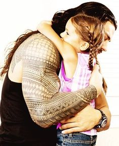 Beautiful picture of Joe Anoa'i (Roman Reigns) hugging his six-year-old daughter Joelle.