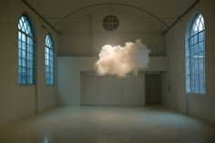 NIMBUS II by Berndnaut Smilde: The clouds are generated using a smoke machine, but Smilde must carefully monitor a room's humidity and atmosphere in order to get the smoke to hang so elegantly, and with such life-like form. Backlighting is used to bring out shadows from within the cloud, to give it that look of a looming and ominous rain cloud.