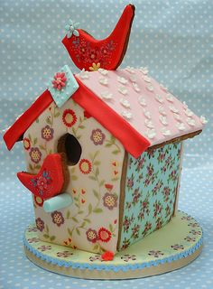 Extraordinary hand painted & decorated gingerbread bird house. Gorgeous!