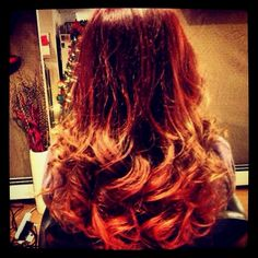 Beautiful red on top of blonde ombre makes darker ombre with naturally red hair.