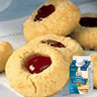 Burnbrae Farms – - Semolina Thumbprint Cookies - Check out this recipe! Kinds Of Cookies, Fancy Cookies, Sugar Cookies, Easy Delicious Recipes, Yummy Food, Tasty, Biscuits, Thumbprint Cookies, Food Displays