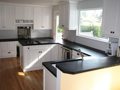 """white shaker style kitchen cabinets. I love the dark counter tops, and this """"eat in"""" is what I am looking for in between our kitchen and dining room...."""